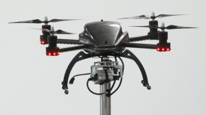A quadrocopter drone equipped with a camera stands on display at the Zeiss stand on the first day of the CeBIT 2012 technology trade fair on March 6, 2012 in Hanover, Germany. (credit: Sean Gallup/Getty Images)